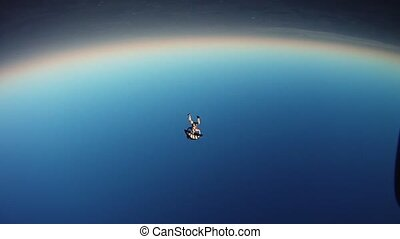 Parachutist unleashes parachute in blue. Dangerous moment....