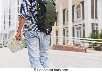 Active male tourist enjoying walk in town - Close up of...