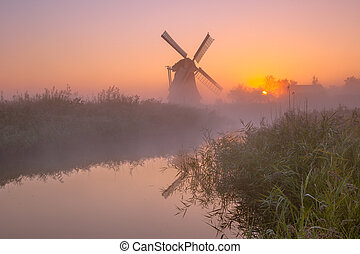 Historic windmill along a river - Characteristic historic...
