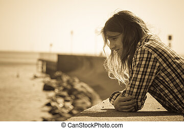 Man outdoor concerned and stressed sad - Man long hair alone...