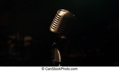 Concert metal glitter microphone stand on stage in retro bar. Smoke. Vintage