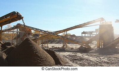 Gravel enterprise is working sorting stones. Industrial...