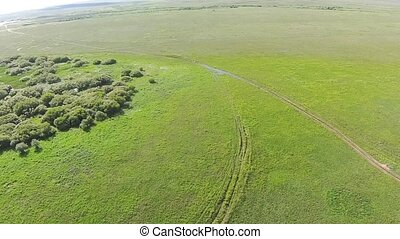 Aerial view of in the steppe Kazakhstan with mud road...