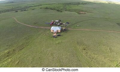 Aerial view of house in the wild steppe of Kazakhstan