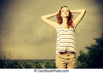 against the wind - Portrait of a beautiful young woman on...