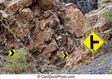 road signs on the mountain road right turn