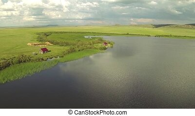 Aerial view of two house in the lake coast, Kazakhstan.