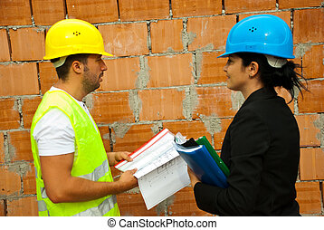Construction workers with project on site