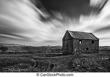 Stunning long exposure black and white landscape of derelict...