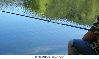 Beautiful views of forest lake with reflection. Fisherman...