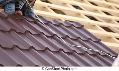 workers install metal roofing brown
