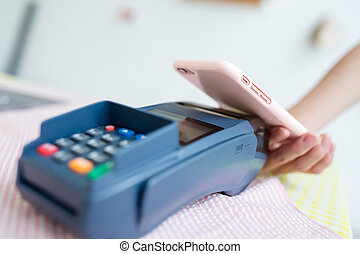 Woman using mobile payment