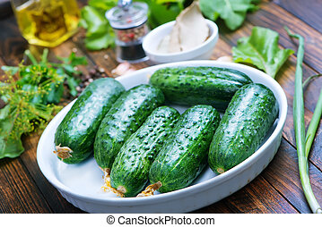 cucumbers - fresh cucumbers with salt and spice on the...