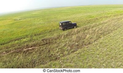 Aerial view of in the steppe off-road car at road