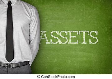 Assets text on blackboard - Accounting concept on blackboard...