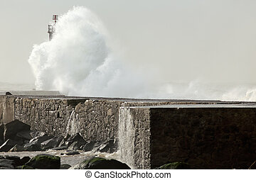 Sunny stormy sea waves over pier and beacon with beautiful...