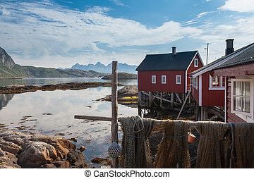 Typical red rorbu fishing hut in town of Svolvaer on Lofoten...