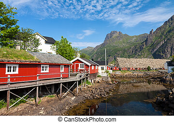 Typical red rorbu fishing hut in town of Svolvaer