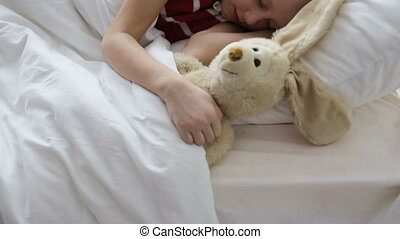 Little girl sleeping in her bed - Young girl with toy sleep...