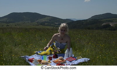 Lady on Picnic Eating Strawberry