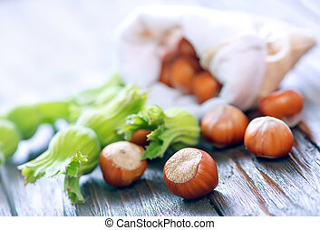 hazelnuts on the wooden table, autumn harvest of nuts