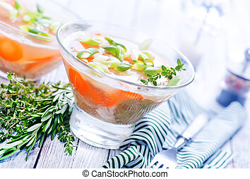 jellied meat with vegetables in glass bowl