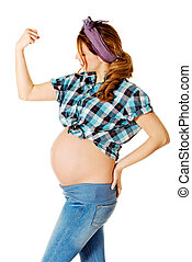 Young pregnant woman showing arm muscles