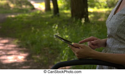 Women with tablet closeup - closeup of women with tablet in...
