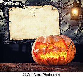 Scary halloween pumpkin with empty sign board