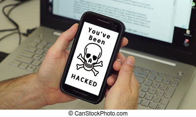 Man With Hacked Mobile Phone - Anonymous man holds his...