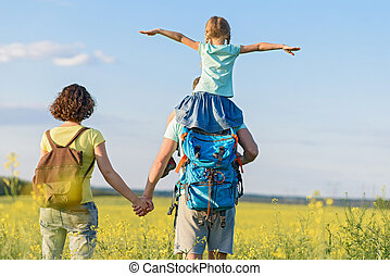 Young family hiking on mountain - This is so much fun with...