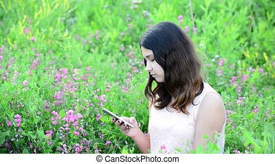 14 year girl writing sms on phone - 14 year girl writing sms...