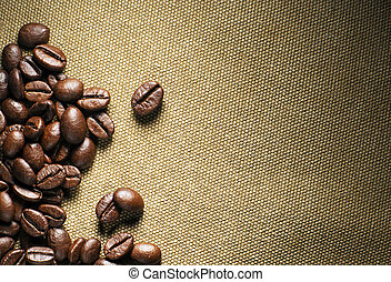 Coffee - Fresh coffee beans on the basis of goods background