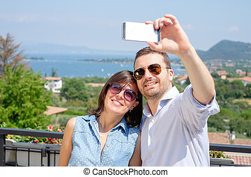 Couple taking selfie during their vacations