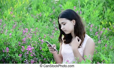 14 year girl uses phone outdoors - 14 year girl uses aphone...