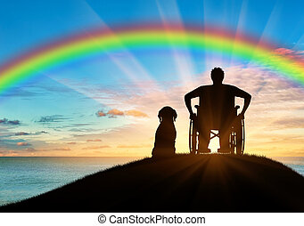 Disabled person in a wheelchair next to his dog -...