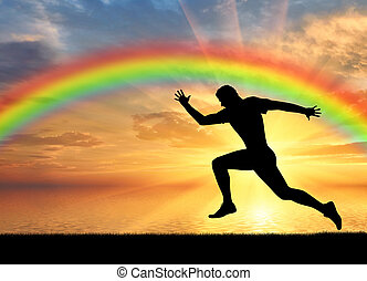Male runner at rainbow background