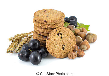Integral cookies with grapes and hazelnuts isolated