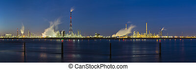 Steaming Harbor Industry At Night Panorama - Panoramic view...