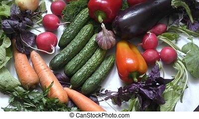 Fresh vegetables and greens on the kitchen table - Fresh...