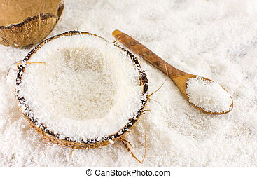 Halved fresh coconut and powder on the table - Halved fresh...