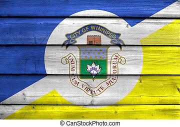 Flag of Winnipeg, Manitoba, Canada, painted on old wood...