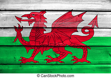 Flag of Wales, UK, painted on old wood plank background