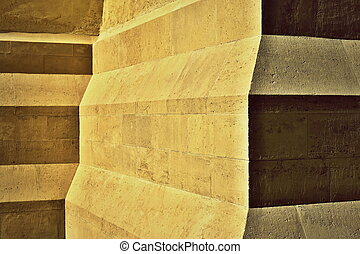 detail of oblique steps on a stone pillar - abstract...