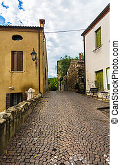 old narrow street of sidewalk pavers in Italy