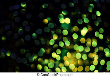 Abstract blurred glitter vintage lights background Green and...