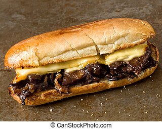 rustic philly cheese steak sandwich - close up of rustic...