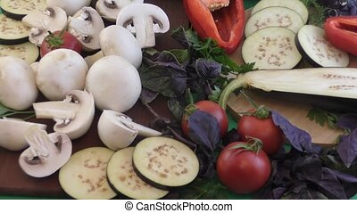 Champignon and fresh vegetables on a kitchen table for...
