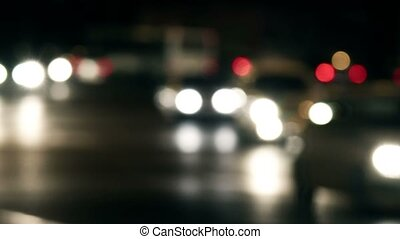 Abstract out-of-focus city night traffic shot.