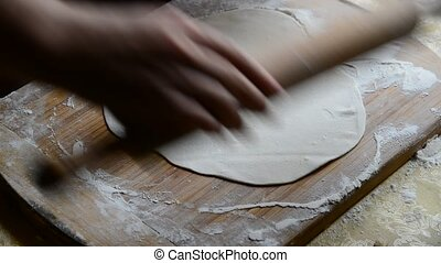 Housewife making chebureks - Georgian national dish -...